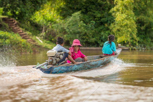 Steung River, Battambng Province, Cambodia - 13 August 2013: Family Make A Trip Up River In Simple Wooden Boat.
