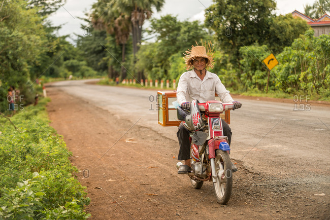 Mobile Salesman, Cambodia - 15 August 2013: Young Khmer Man Sells Snacks From His Motorbike.
