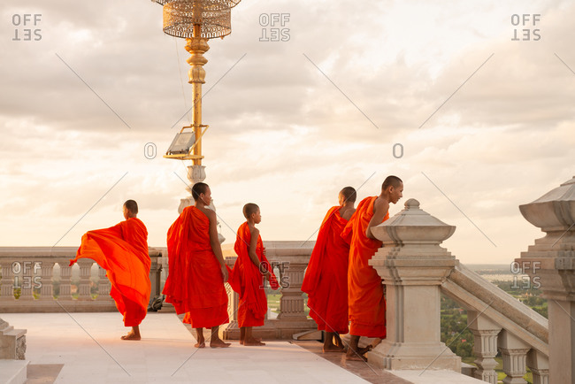 Monks, Udong, Cambodia - 16 August 2013: Monks Stand At The Top Of The Stairs Of Modern Temple Housing Ancient Relics And Buddhas On Udong Mountain.