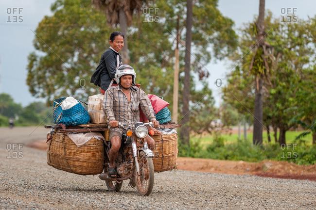 Overloaded Motorbike, On The Road, Cambodia - 09 September 2013: Khmer Family Return From Local Market.
