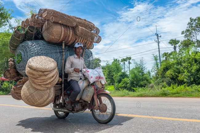 Mobile Salesman, On The Road, Cambodia - 16 September 2013: Motorbike Overloaded With Baskets.