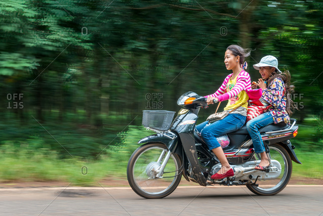 On The Road, Cambodia - 02 October 2013: Girls Have Fun On Motorbike.