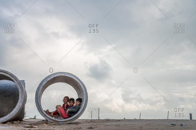 Kids Play, Cambodia - 05 October 2013: Children In Drainage Pipe.