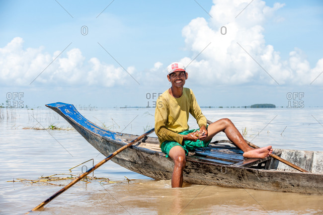 Angkor Borei, Takeo Province, Cambodia - 11 November 2013: Khmer Fisherman Holds Local Specialty Of Fresh Water Kray Fish.