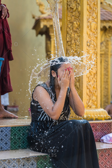 Wat Khleang, Phnom Penh, Cambodia - 06 February 2014: Monk Performs Cleansing Ceremony On Lay People Who Want To Be Blessed.