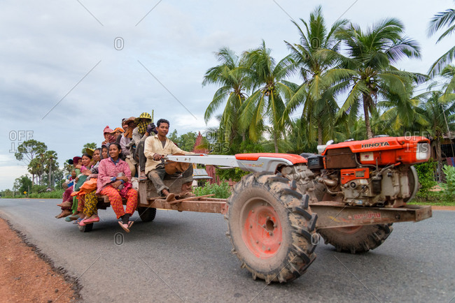On The Road, Cambodia - 23 June 2014: Rice Paddy Helpers Go To Work On Mechanical Buffalo.
