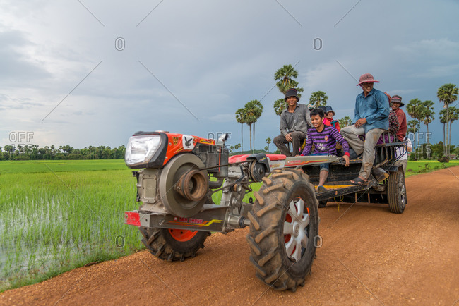 Kompong Chnang, Cambodia - 28 July 2014: Cambodian Farm Workers Return Home On Trailer Truck Attached To A Mechanical Buffalo.