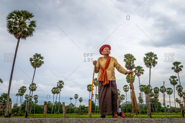 Kompong Chnang, Cambodia - 28 July 2014: Old Cambodian Lady Waits For Transport To Take Her Home In Rural Countryside.