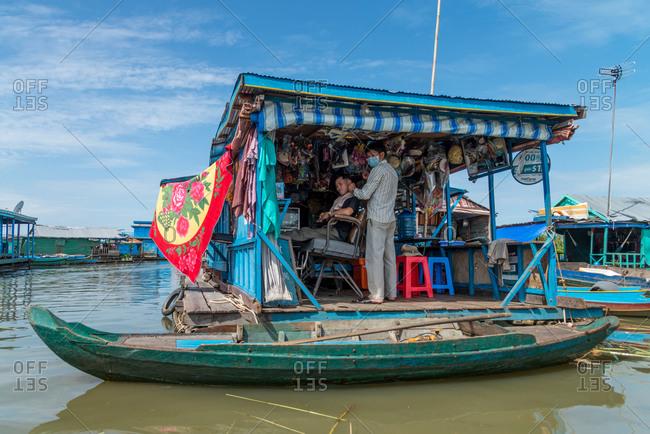 Kompong Luong Floating Village, Krakor District, Cambodia - 29 July 2014: Floating Hairdresser In Cambodian Floating Village.