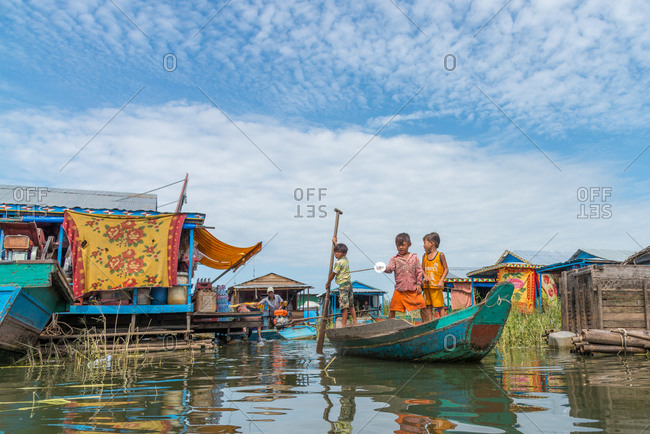 Kompong Luong Floating Village, Krakor District, Cambodia - 29 July 2014: Young Khmer Boys Play Pirates In Cambodian Floating Village.