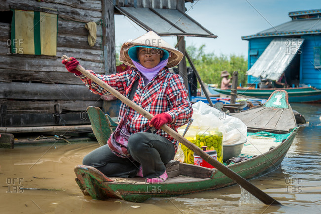 Kompong Luong Floating Village, Krakor District, Cambodia - 29 July 2014: Khmer Women Rows Through Cambodian Floating Village.