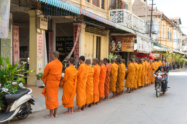 Monks Doing Alms, Battambang, Cambodia - 13 August 2014: Long Line Of Monks In Streets Expecting Local Business Owners To Make Donations .