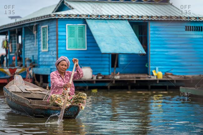Kompong Luong Floating Village, Krakor District, Cambodia - 23 October 2014: Khmer Women Rows Through Cambodian Floating Village.