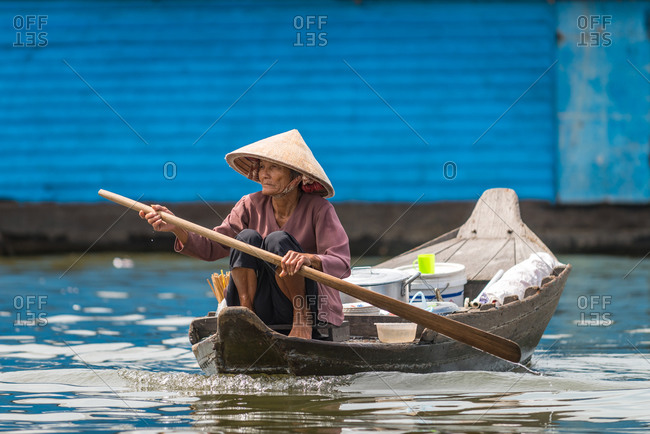 Kompong Luong Floating Village, Krakor District, Cambodia - 23 October 2014: Elder Khmer Women Rows Through Cambodian Floating Village.