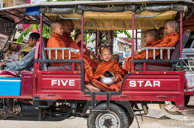 Monk In Tuk Tuk, Battambang, Cambodia - 24 October 2014: Young Khmer Monks Prepare To Be Transported Back To Their Temple After Making Daily Alms In Town.