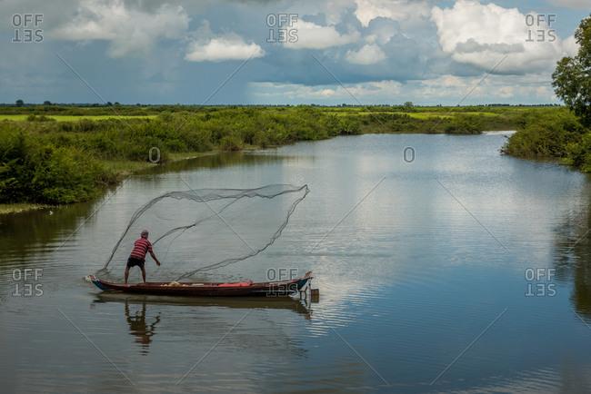Throwing Fishing Net, Battambang Province, Cambodia - 25 October 2014: Fisherman Hopes To Catch Fish.
