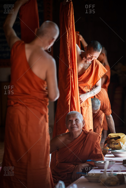 Monks, Vipassana Center, Udong, Cambodia - 15 December 2014: Monks Prepare Their Robes Before Sitting Down To For Lunch.