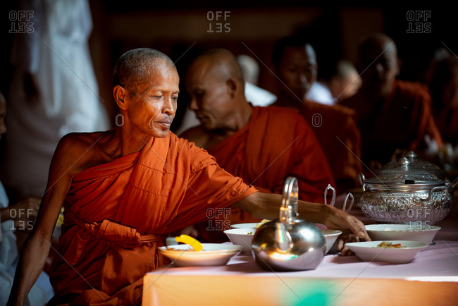 Monks, Vipassana Center, Udong, Cambodia - 15 December 2014: Monks Sit Down For Lunch In Main Dinning Hall.