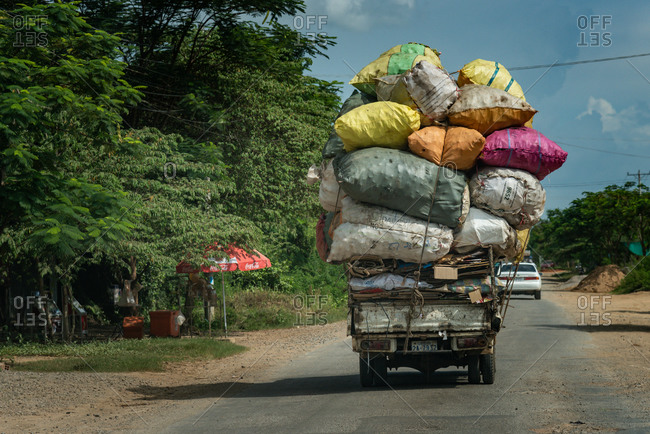 On The Road, Cambodia - 13 August 2014: Overloaded Vehicle Transports Recyclables On Country Road.