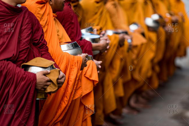 Monks Doing Alms, Battambang, Cambodia - 17 December 2014: Long Line Of Begging Bowls Expecting Donations Of Rice In Support Of Monks Spiritual Quest.