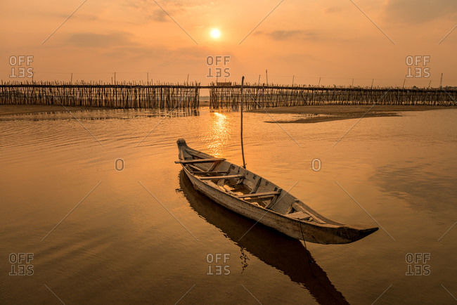 Wooden Boat At Sunset, Ko Paen Bamboo Bridge, Kompong Cham, Cambodia. This Temporary Bamboo Bridge Is Reconstructed Every Year To Span A Contributory To The Mekong From Main City To An Island.