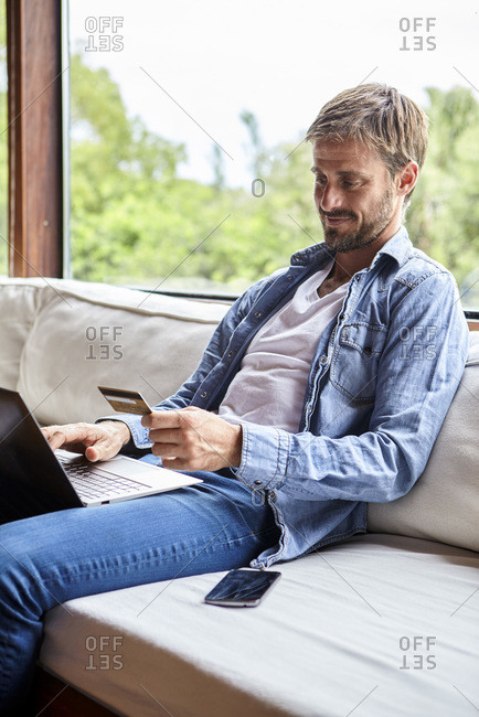 Mid adult man making online payment
