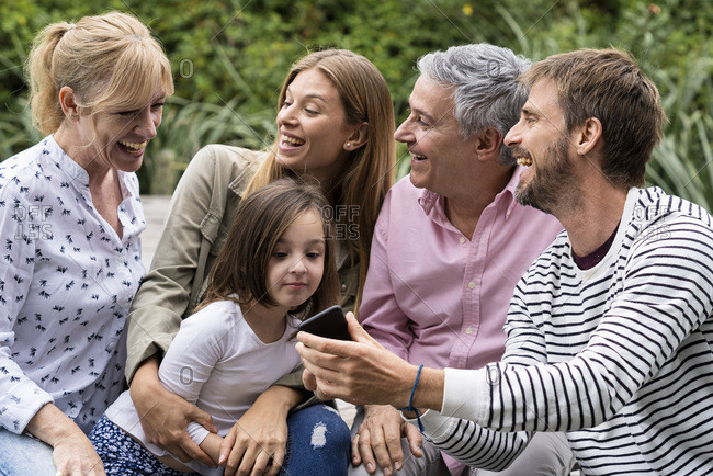 Happy Family looking at smartphone