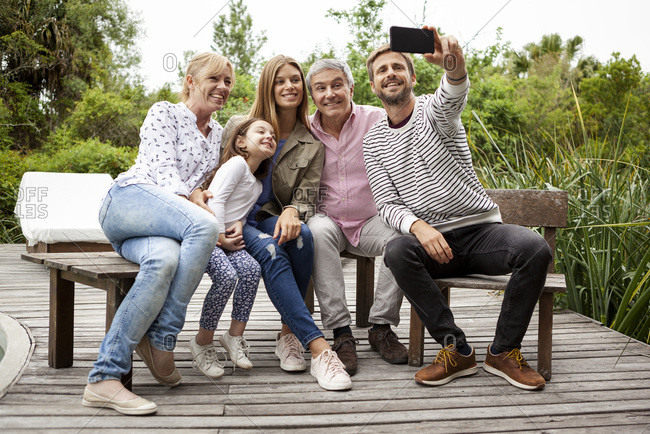 Happy loving family taking selfie