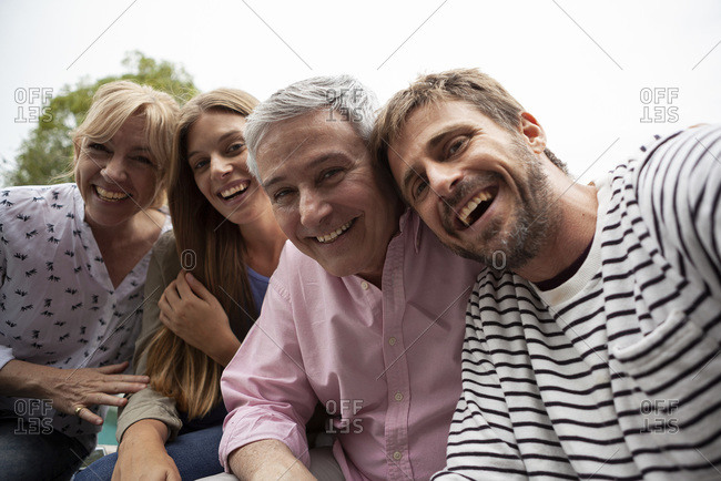Portrait of happy family sitting together
