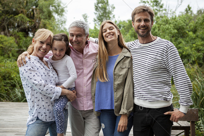 Portrait of happy family standing together