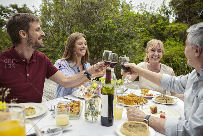 Happy family toasting wine glasses
