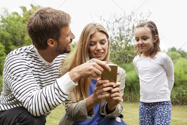 Happy Happy Family using smartphone