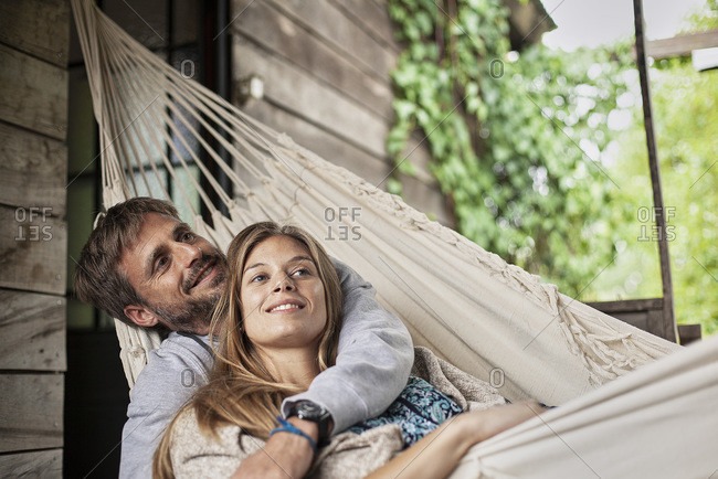 Thoughtful couple relaxing in hammock