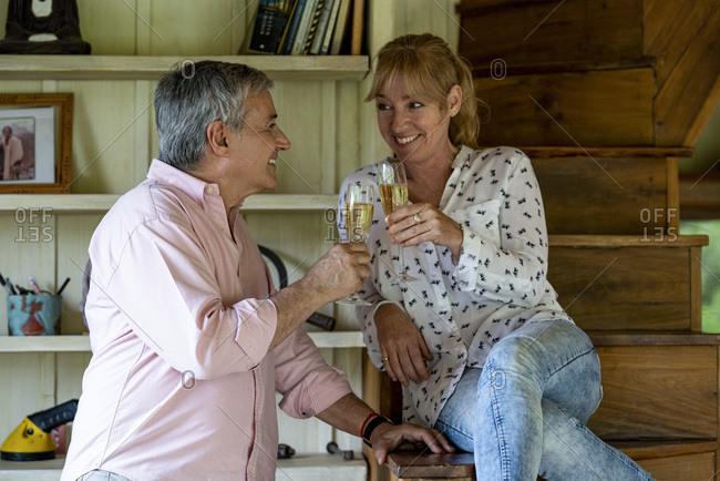 Senior couple toasting champagne flutes