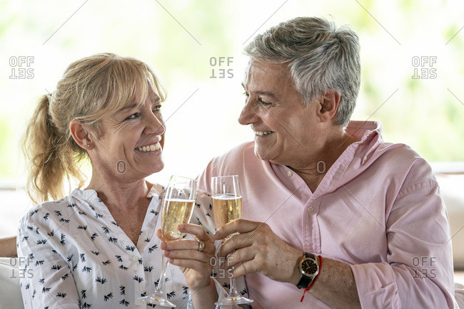 Senior couple drinking champagne together