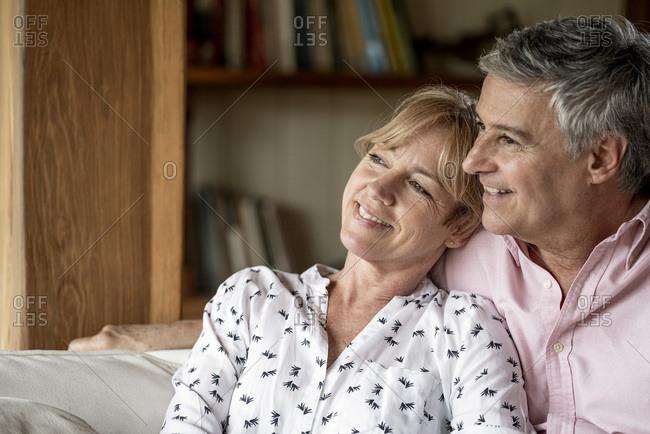 Senior couple relaxing in stilt hut