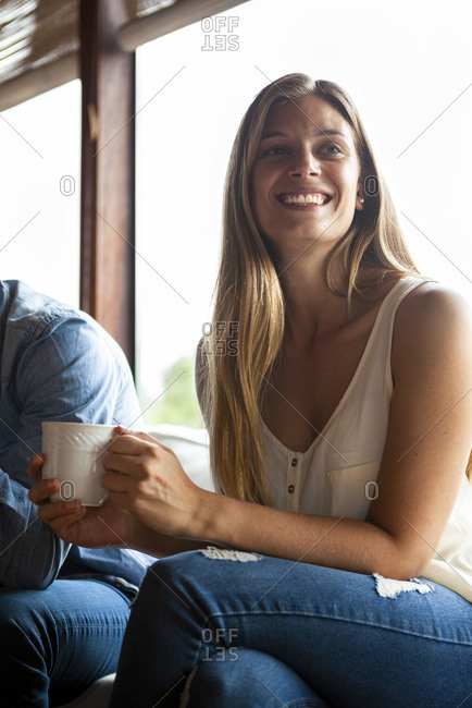 Smiling mid adult woman having coffee