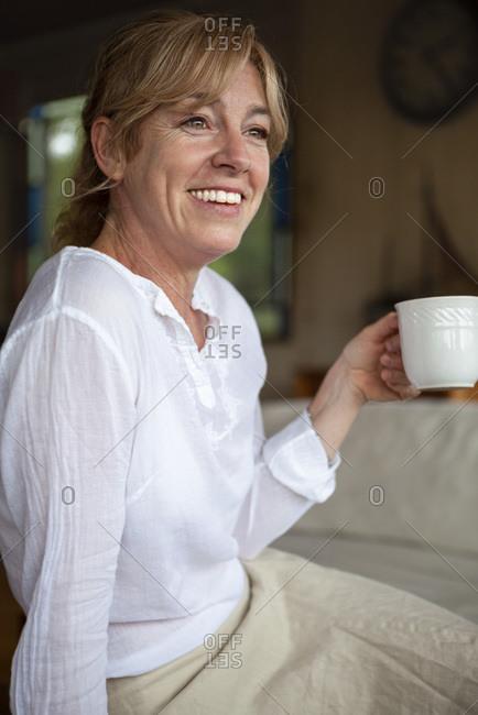 Smiling senior woman having coffee