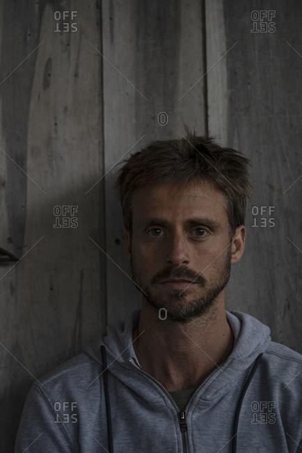 Man sitting in stilt hut