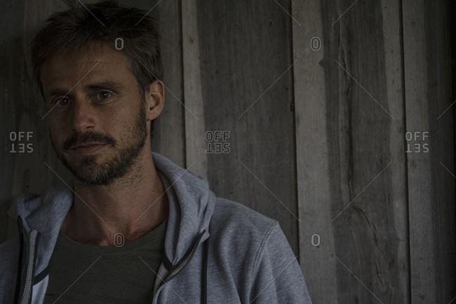 Man standing in stilt hut