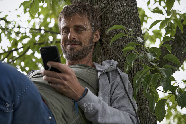 Man using smartphone to communicate with others