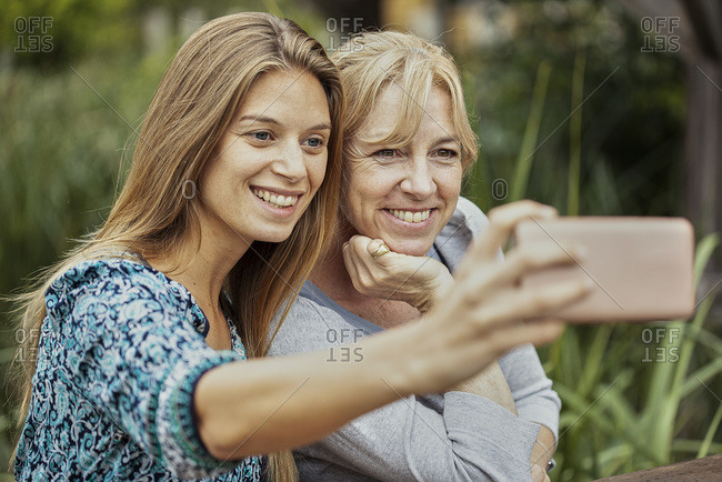 Woman with her mother in law taking selfie