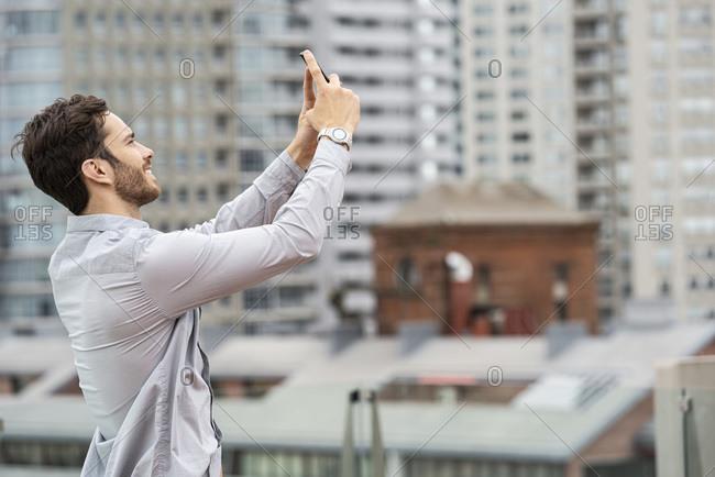 Young man taking selfie of himself