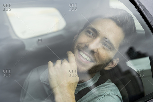 Young man travelling by taxi
