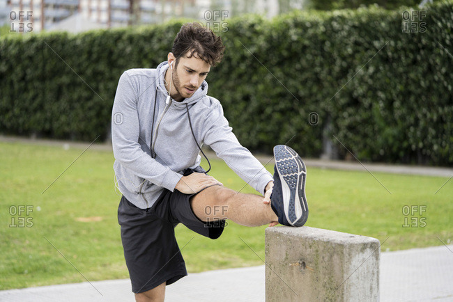 Young man exercising in public park