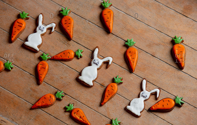 Cookie easter rabbit and carrots on wooden table