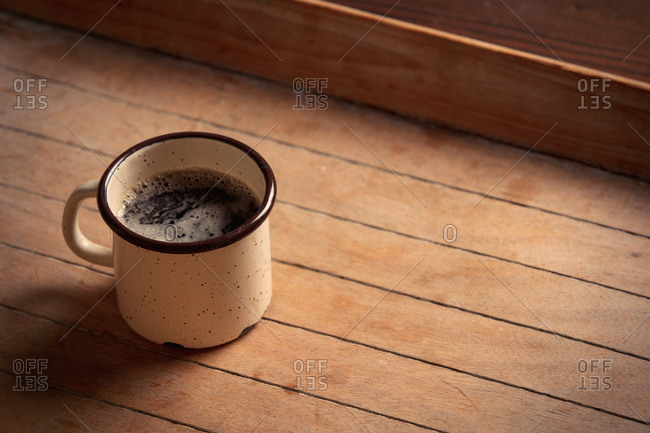 Side view on cup of coffee on wooden table