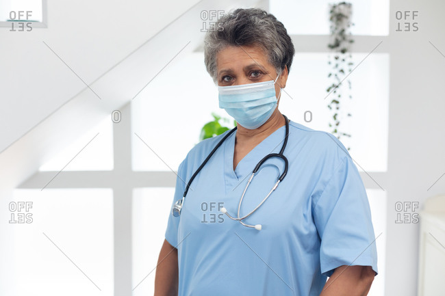 Portrait of senior African American female doctor wearing a face mask looking at the camera. healthcare hygiene protection during coronavirus covid 19 pandemic.