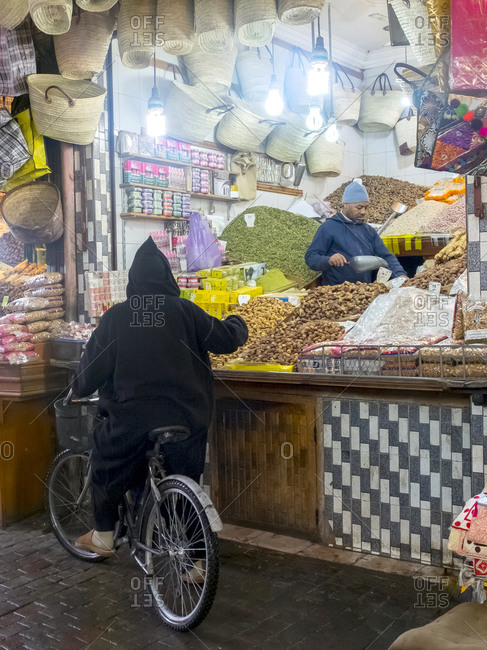 MARRAKESH, MOROCCO, JANUARY 2017: Street photo of moroccan local people on central medina covered market