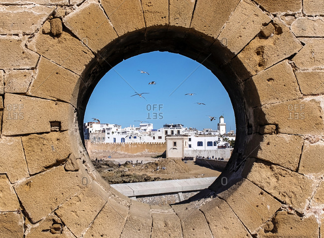 View of Essaouira (Morocco) through a hole in the wall of the fortress